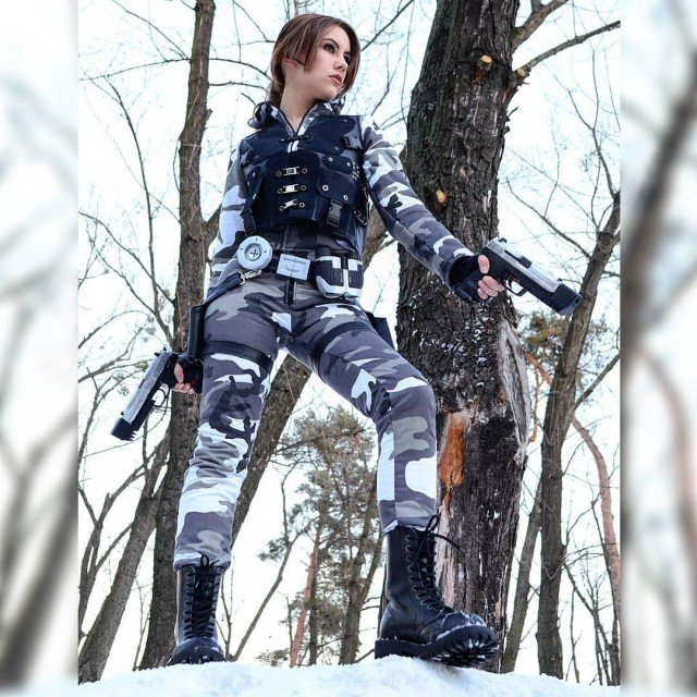 Girl in camo with guns - what could be better?...